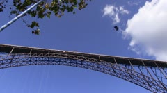 View of bridge, sky and parachute from the ground Stock Footage