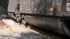 Close up of train going past on tracks Stock Footage
