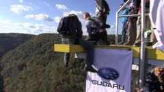 Base jumper jumping from platform Stock Footage