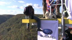 Base jumper jumps from bridge platform Stock Footage