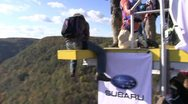 Stock Video Footage of Base jumper jumps from bridge platform