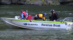 Rescue Boat pulling base jumper out of New River Stock Footage