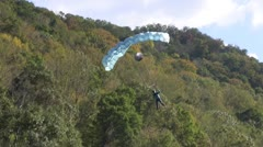 Base jumper landing in the New River Stock Footage