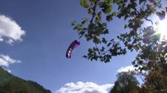 Base jumper on a beautiful fall day coming in for a landing Stock Footage