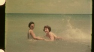 Women in the Waves at the Beach Circa 1955 (Vintage Film 8mm Home Movie) 939 Stock Footage