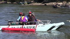 Raft carrying base jumpers on New River Stock Footage