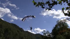 Base jumper coming in and landing by the New River Stock Footage