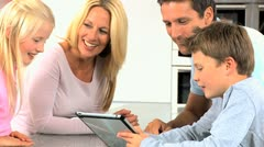 Young Caucasian Family Having Fun with  Wireless Tablet Stock Footage