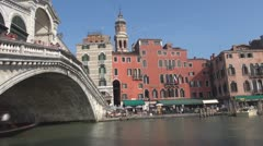 Gondolas, boats and Rialto Bridge, Venice, Italy Stock Footage