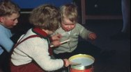 Stock Video Footage of Toodler playing toy drum (Vintage 8 mm amateur film)