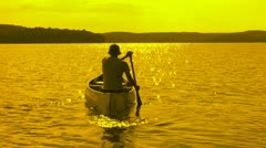 Stock Video Footage of Golden canoeist.
