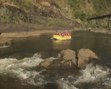 People in raft going down river Stock Footage