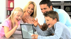 Caucasian Family Using Online Video Chat with Relatives Stock Footage