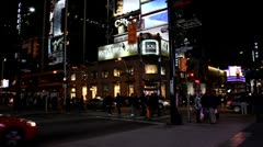 Yonge Street in Toronto at night across from Eaton Center Stock Footage