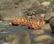 Rafts stopping by side of river SD Footage