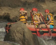 Close up of raft going round rocks - stock footage