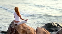 The young woman is practising the yoga. holiday relaxation. Stock Footage