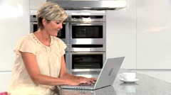 Mature Lady with Laptop Having Success Online Stock Footage
