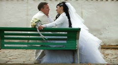 Just married couple sitting  in autumn park Stock Footage