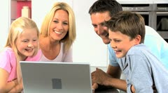 Stock Video Footage of Young Caucasian Family Using Laptop Computer