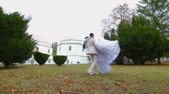 Groom spinning around  bride Stock Footage