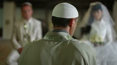 Imam preaching in mosque during wedding ceremony Stock Footage