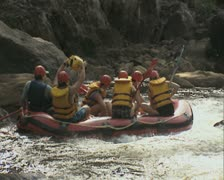 Rear view of raft going down river - stock footage