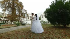 just married Crimean Tatar couple posing against mosque - stock footage