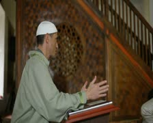 Imam preaching in a mosque - stock footage