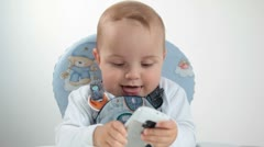Baby and phone. - stock footage