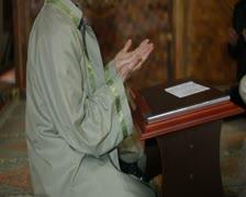 Mullah praying in mosque - stock footage