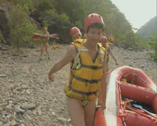 Carrying raft to river Stock Footage