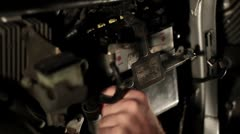 The mechanic disassembled the battery of the motorcycle Stock Footage