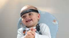 Baby wearing a headband. - stock footage