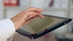 Female hands with tablet computer, indoors Stock Footage