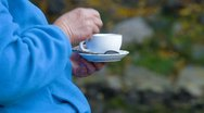 Senior woman hands holding white coffee cup Stock Footage