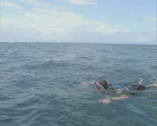 Woman snorkelling past camera Stock Footage
