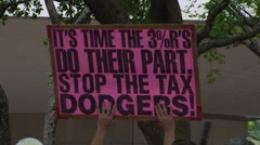 Stock Video Footage of Occupy Wall Street: Tax Dodgers Sign