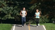 Stock Video Footage of AA076401 jogging fitness young happy people park run 1