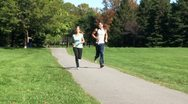 AA075401 jogging fitness young happy people park Stock Footage