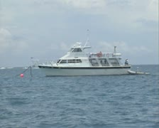 Dive Boat moored on sea Stock Footage