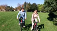 AA074201 cycle young happy couple people cycling Stock Footage