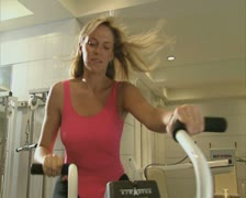 Woman using gym equipment Stock Footage
