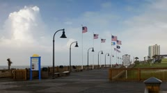 Flags over boardwalk at Myrtle Beach Stock Footage