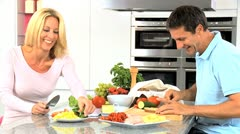 Caucasian Couple in Home Kitchen Preparing Lunch Stock Footage