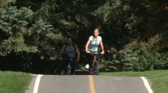 Stock Video Footage of AA077501 cycle young happy couple people cycling