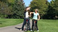 AA078201 cycle young happy couple people cycling Stock Footage