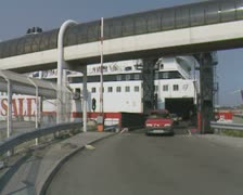 Red car driving off ferry Stock Footage