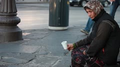 Woman homeless in city begging Stock Footage