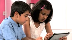 Asian Siblings Using Wireless Tablet - stock footage